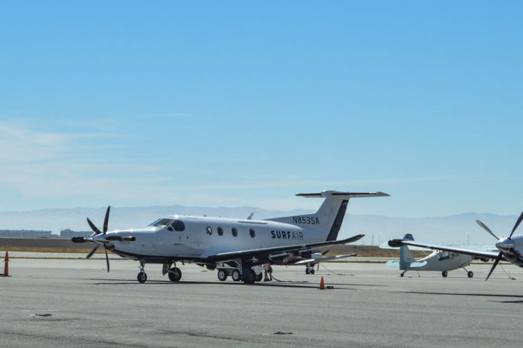 Two Surf Air planes at KSQL
